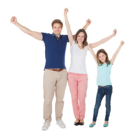 Full length portrait of excited family against white background