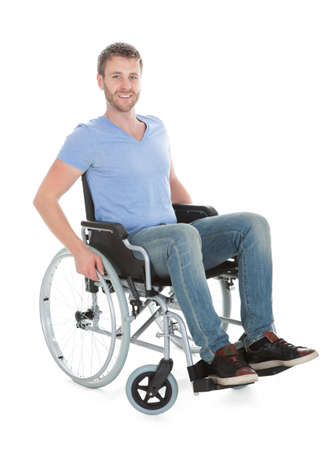 Full length portrait of disabled man on wheelchair over white background
