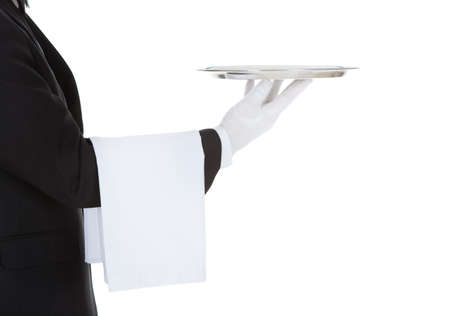 butler: Cropped image of waiter holding empty tray over white background