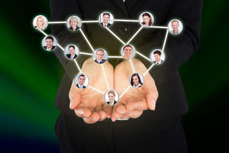 Digital composite image of businesswoman holding connected team representing leadership photo