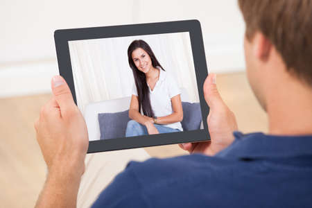 Cropped image of man video chatting with woman at home Stock Photo - 30787453