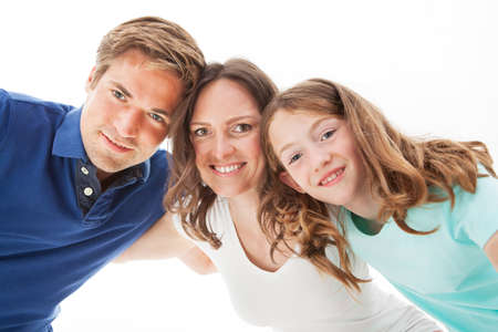 Portrait of happy family isolated over white background photo