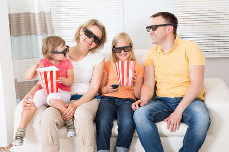 Young Family Watching 3D TV At Home photo