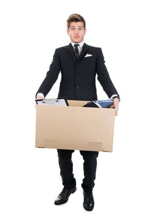 cardboard cutout: Full length portrait of businessman carrying cardboard box against white background