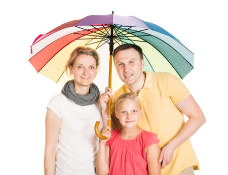 Insured Family Standing Under Umbrella. Isolated On White photo
