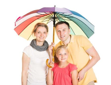 Insured Family Standing Under Umbrella. Isolated On White Reklamní fotografie