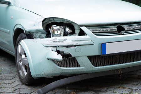 damaged car: Closeup photo of broken car on street Stock Photo
