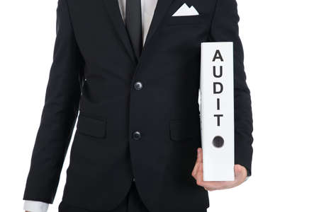 financial audit: Midsection of young businessman holding Audit folder against white background