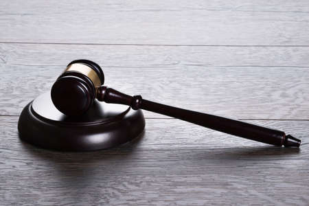 verdicts: Gavel on the the table in law and justice concept Stock Photo