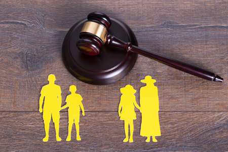 divorce court: Gavel on the table and paper family representing divorce Stock Photo