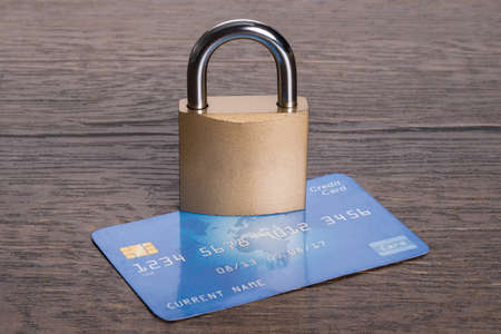 safe payment: Credit card and lock in secure transactions concept