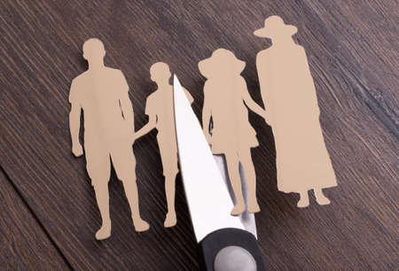 Scissors cutting paper family representing family divorce photo