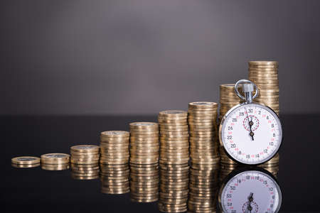 cash on hand: Time is money concept over black background Stock Photo