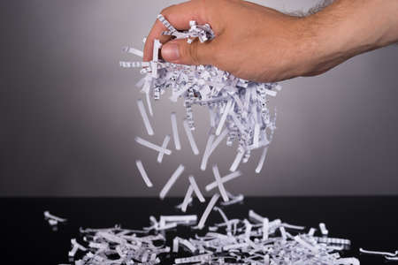 shredding: Shredded documents in security concept over black background