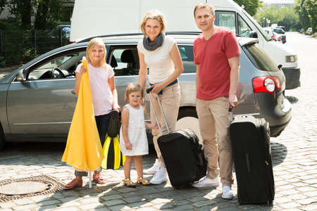 Happy Family Traveling By Car. Outdoors Shot photo
