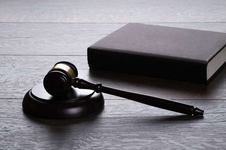 legal court: Gavel and book on the table in legal concept