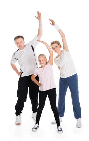 family exercise: Young Family Doing Fitness Together. Isolated On White Stock Photo