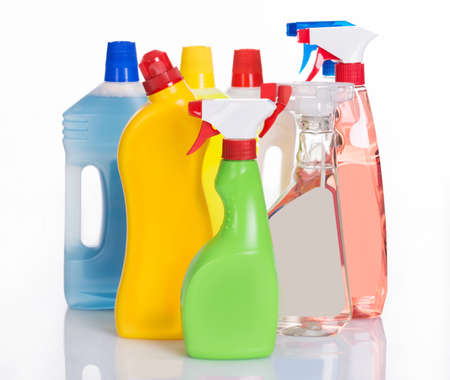 Bottles with cleaning detergents. Isolated on white Stock Photo