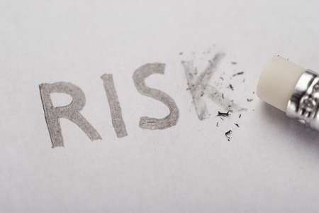risk: Eliminating risk pencil written word from paper
