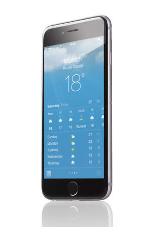 Berlin; Germany - October 10; 2014: Apple iPhone 6 with application of weather forecast for the city of Munich isolated over white background. Apple iPhone6 was launched on September 19; 2014
