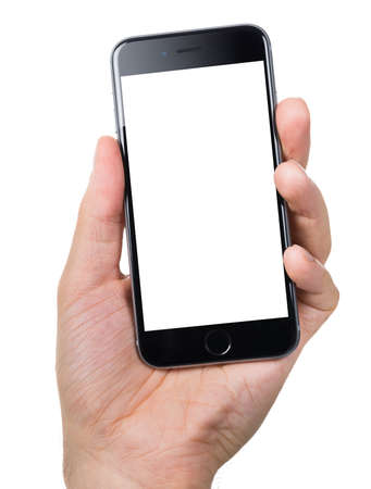 Berlin; Germany - October 10; 2014: Cropped image of hand holding Apple iPhone6 with blank screen against white background. Apple iPhone6 was launched on September 19; 2014