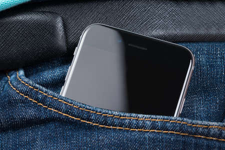 Closeup of Apple iPhone 6 with blank screen in mans pocket. Apple iPhone 6 was launched on September 19; 2014