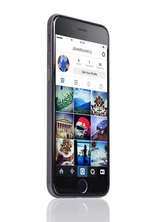 Berlin; Germany - October 10; 2014: Apple iPhone 6 with Instagram profile on screen isolated over white background. Instagram is an online mobile social networking service; launched in October 2010