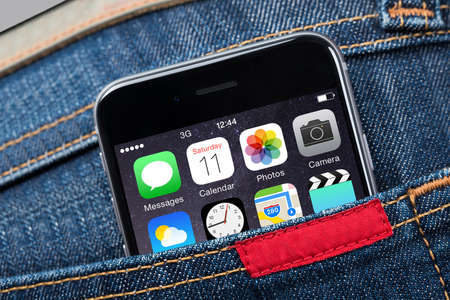 Closeup of Apple iPhone 6 with various apps in mans pocket. Apple iPhone 6 was launched on September 19; 2014