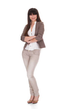 Full length portrait of beautiful young businesswoman standing arms crossed over white background photo