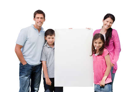 man holding sign: Portrait of happy family holding blank billboard isolated over white background