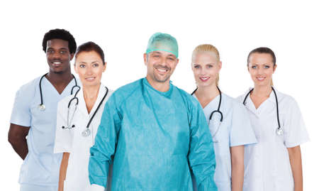 Portrait of confident medical team standing against white background photo