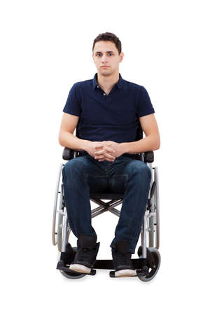 Full length portrait of confident man sitting with hands clasped in wheelchair isolated over white background