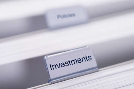 Closeup of Investments and Policies tabs on folders photo