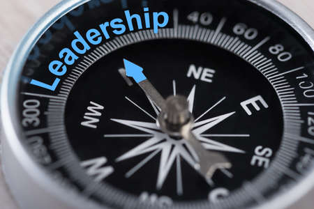 Closeup photo of compass indicating Leadership concept photo