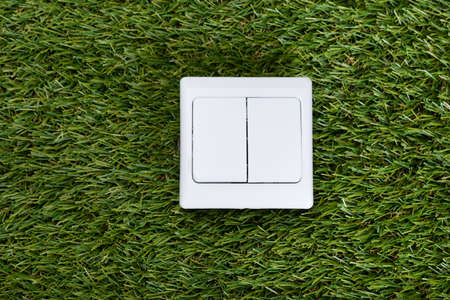resource conservation: Directly above shot of switch on grass Stock Photo