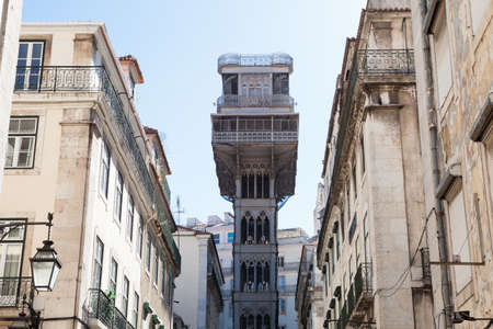 elevador: Low angle view of historic tower between buildings; Portugal; Europe Stock Photo