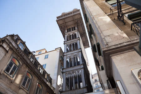 elevador: Low angle view of historic tower against blue sky; Portugal; Europe
