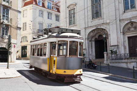 citylife: Classic tram moving on street in city; Portugal; Europe