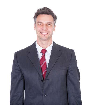 waistup: Portrait of smiling businessman against white background