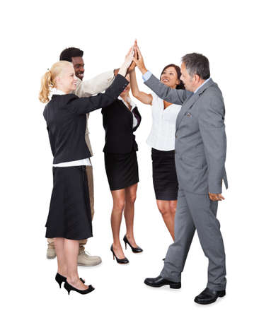 winning business woman: Full length of multiethnic business team joining hands over white background