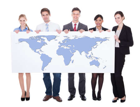 worldmap: Full length portrait of confident businesspeople holding worldmap against white background. Source of reference map: http:visibleearth.nasa.govview.php?id=74518. Illustration was created on the 15th of May, 2014 using Photoshop CS5. 1 layer of data was Stock Photo