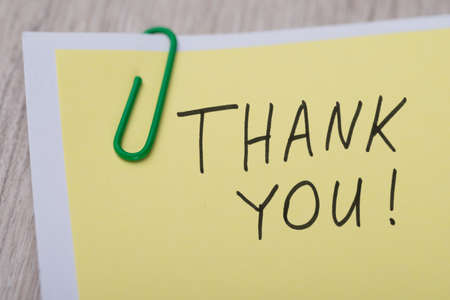 note of exclamation: Closeup of Thank You ! written on yellow paper note with paperclip
