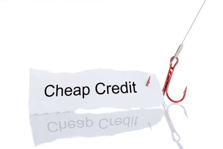 fishhook: Cheap Credit paper trapped in fishhook isolated over white background Stock Photo