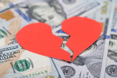 dollar: Closeup of red broken heart on dollar bills