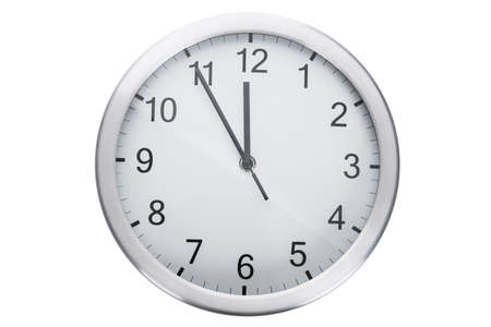 timekeeper: Clock showing five minutes to twelve against white background Stock Photo