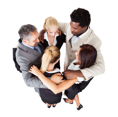 High angle view of multiethnic business people forming huddle over white background
