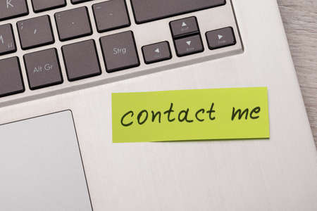 significant: Closeup of Contact Me sticky note message on laptop