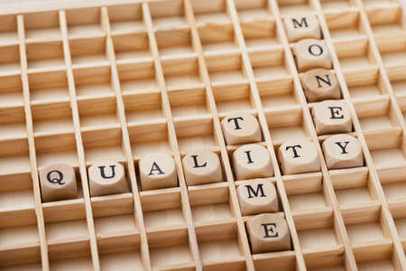 managing money: Closeup of Quality, Time and Money arranged in crossword
