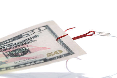 fifty dollar bill: Closeup of fifty dollar bill trapped in fishing hook against white background Stock Photo
