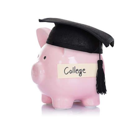 Piggybank with mortar board and college label isolated over white background
